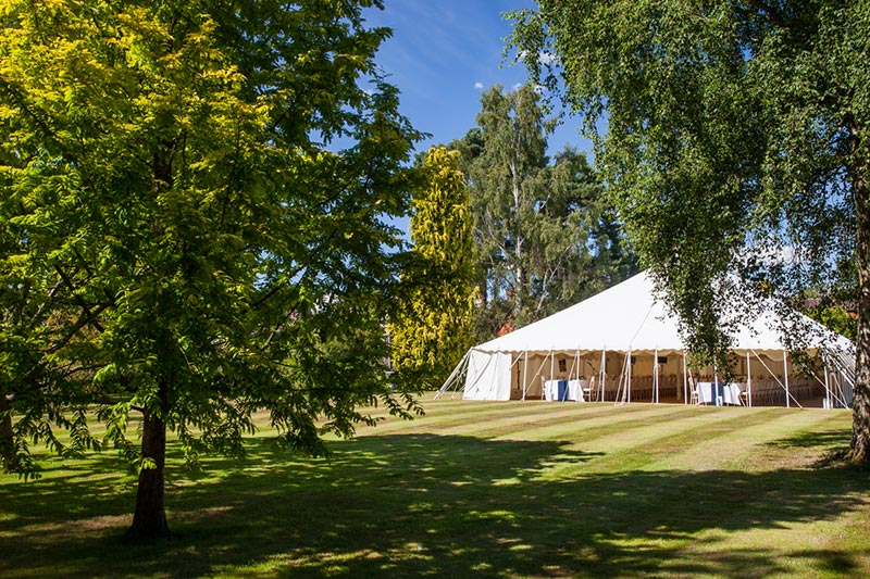 Open sided wedding marquee in summer | Lewis Marquees