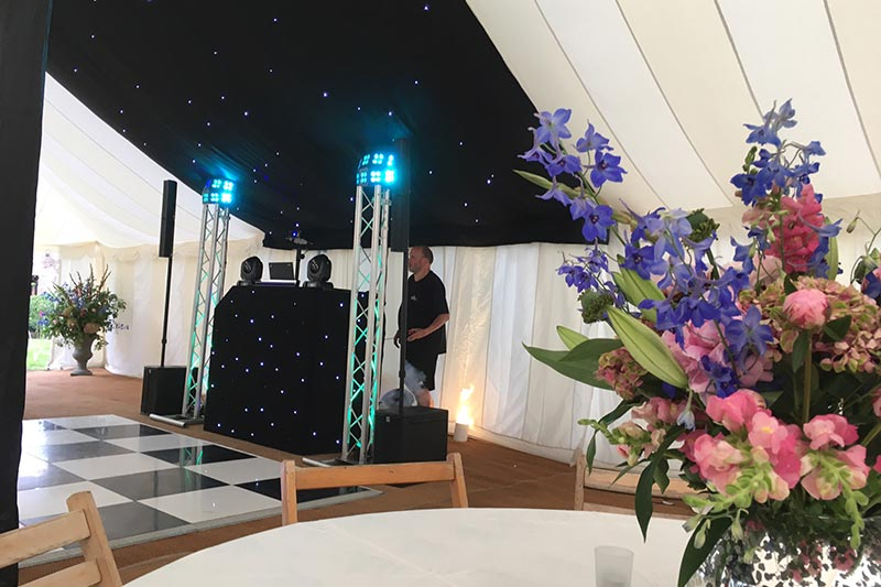 Wedding DJ in marquee with dancefloor | Lewis Marquees