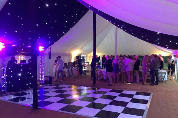 Party event in marquee with dancefloor } Lewis Marquees