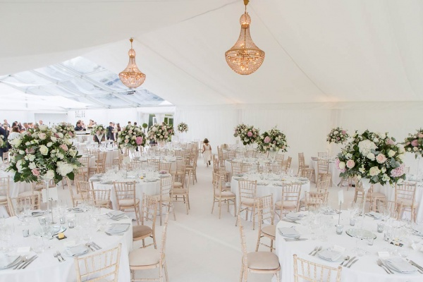 Wedding with white linings and chandeliers | Lewis Marquees